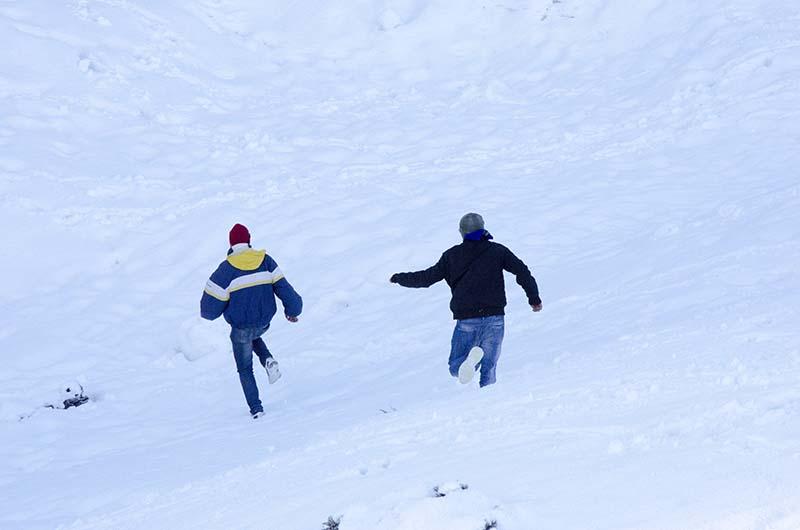 having fun in snow in auli