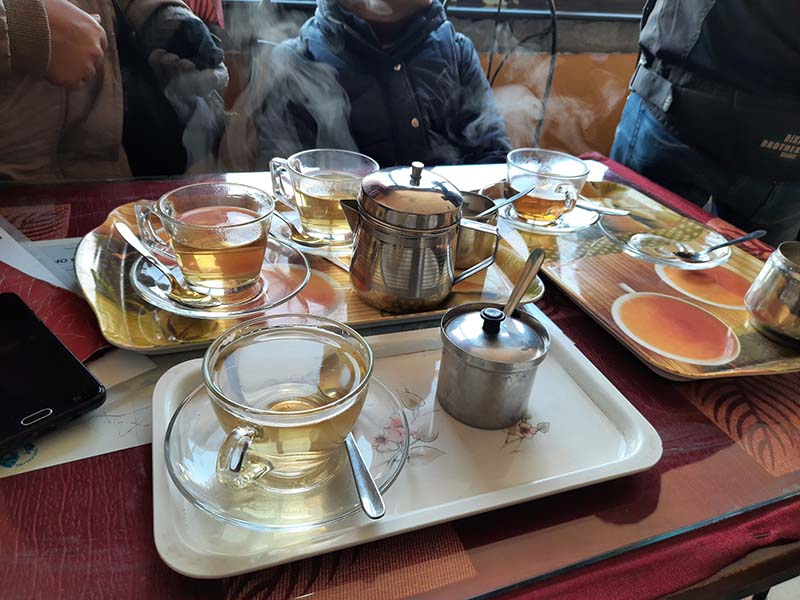 enjoying tea in darjeeling